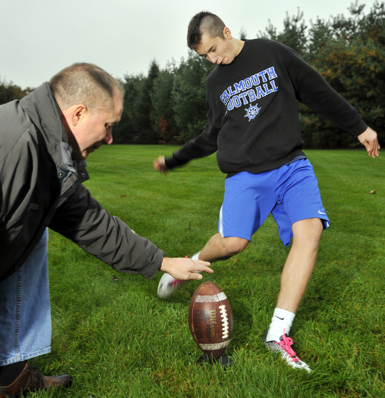 Joe Goodrich kicks out of the hold of his father, Jim Goodrich. Kicking is a bit of a family trade for the Goodrich clan, with Joe's father, Jim, Uncle Steve, and brother, David all kicking after high school.