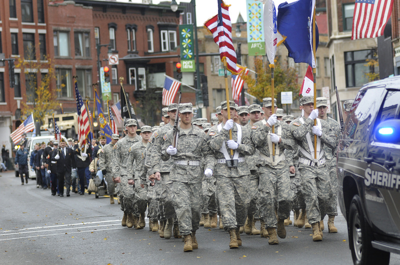 The Veterans Day parade processes down Congress Street in Portland today.