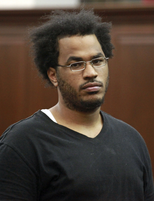 """Jose Pimentel is arraigned at Manhattan criminal court on Sunday in New York. Pimentel, an """"al-Qaida sympathizer"""" accused of plotting to bomb police and post offices in New York City as well as U.S. troops returning home, was charged with criminal possession of explosive devices with the intent to use in a terrorist manner."""