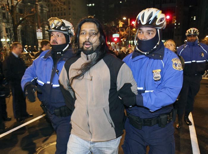 Police arrest a member of Occupy Philly this morning as they began pulling down tents and telling demonstrators they had to leave.