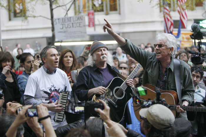 David Crosby, center, and Graham Nash, right, perform at the Occupy Wall Street encampment at Zuccotti Park on Nov. 8 in New York.