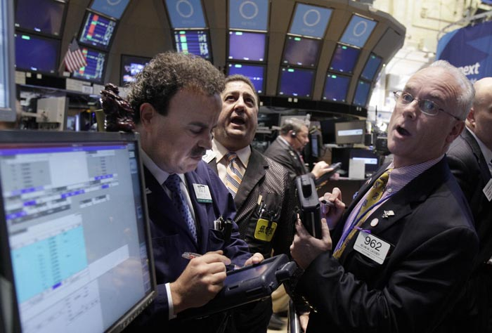 Traders react on the floor of the New York Stock Exchange today as tocks soared in morning trading after major central banks acted together to support the global financial system.