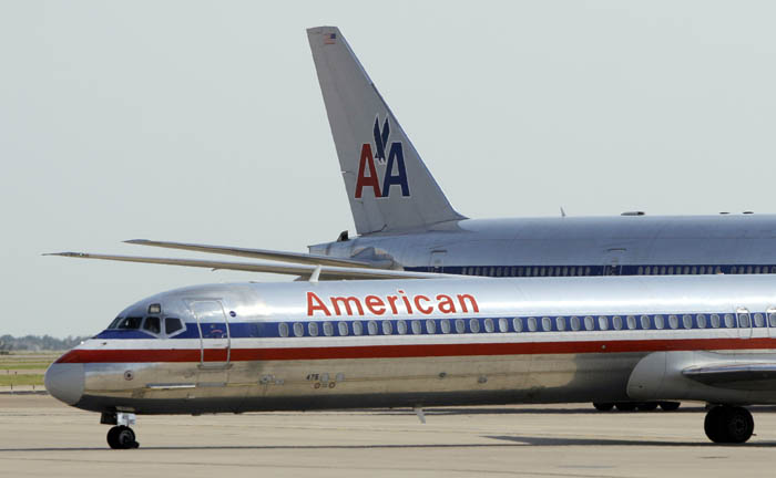 FILE - In this June 29, 2011 file photo, an American Airlines aircraft at Dallas-Fort Worth International Airport, in Grapevine, Texas. The parent companies of American Airlines and its regional affiliate American Eagle are filing for Ch. 11 bankruptcy protection Tuesday, Nov. 29, 2011. (AP Photo/Tony Gutierrez, File)