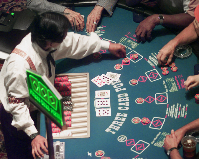 Gamblers will soon be able to place their bets on blackjack, craps and other table games in Maine. In this photo, a casino employee deals a game of poker at Station Casino in Kansas City, Mo.
