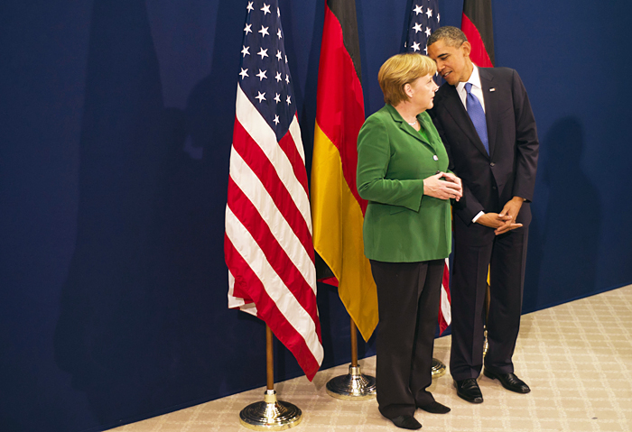 In this picture released by the German government's press office, President Barack Obama talks with German chancellor Angela Merkel, prior to the start of the G20 summit in Cannes, France, today.