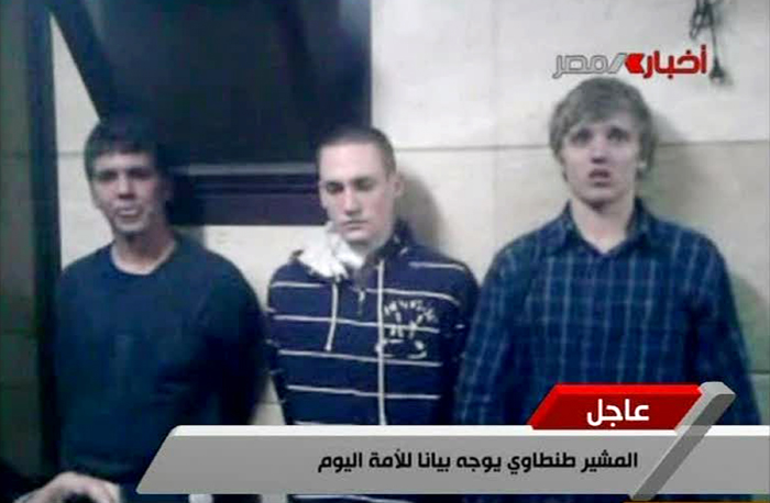 In this Tuesday image from Egyptian state television, three American students are displayed to the camera by Egyptian authorities following their arrest during protests in Cairo.