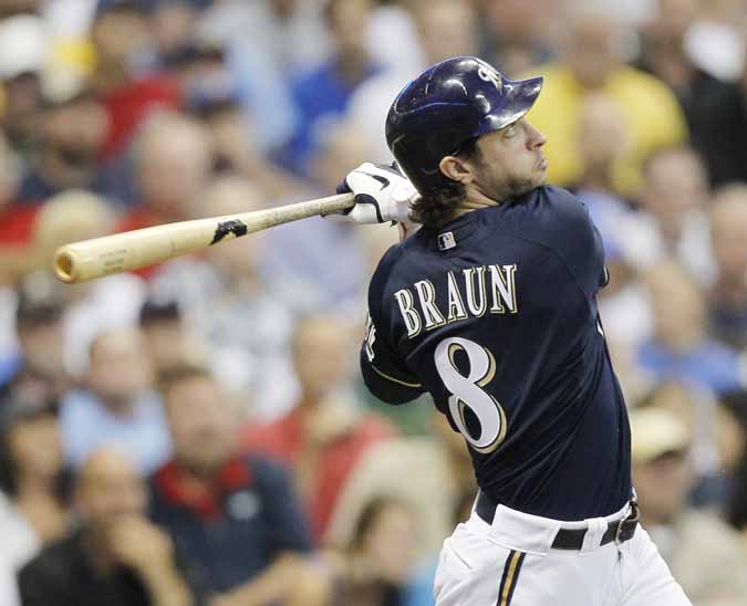 Milwaukee Brewers' Ryan Braun follows through for a home run during a game against the Los Angeles Dodgers.