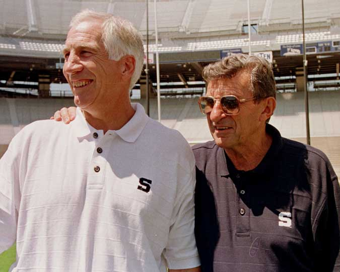 In this Aug. 6, 1999, photo, Penn State head football coach Joe Paterno, right, poses with Jerry Sandusky, his defensive coordinator at the time.