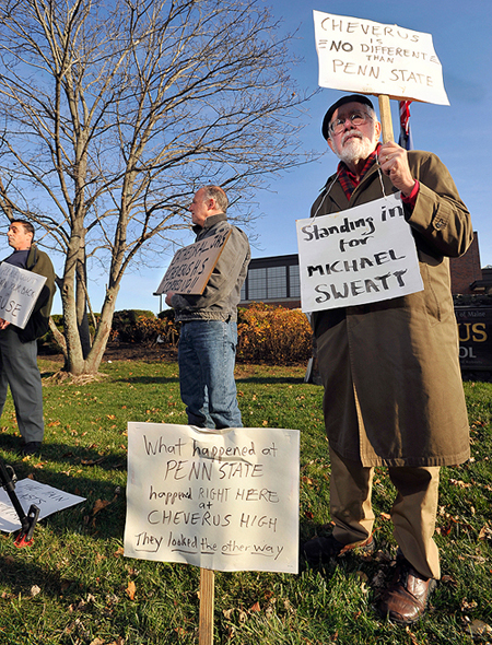 Bill Slavick, right, joins the protest in front of Cheverus High School, as does Rick Romano, middle, who said he was abused in Cathedral School by a teacher who was later hired at Cheverus, according to Romano. John Clark, left, said he was abused as well, according to Clark.