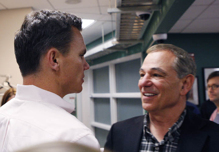 ESPN analyst Bobby Valentine, right, shakes hands with Boston Red Sox general manager Ben Cherington following his interview for the vacant Boston Red Sox manager position at Fenway Park on Nov. 21, 2011. Valentine has acknowledged that it's tough waiting for the Red Sox to make a decision and that he really wants the job.