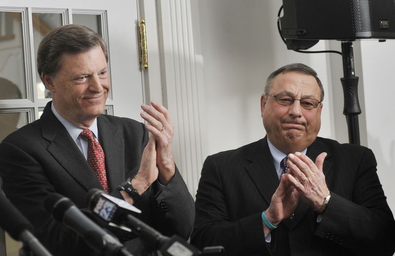 Former Gov. John McKernan, left, and Gov. Paul LePage applaud the fundraising effort in support of Maine's community colleges at Southern Maine Community College in South Portland on Monday.