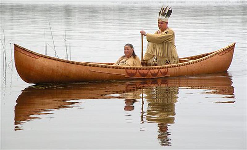 This October 2011 photo provided by the Passamaquoddy tribe shows Chief Joseph Socobasin paddling a birch canoe with his grandmother Joan Dana in Indian Township, Maine. Though Maine voters rejected a racetrack casino on Nov. 8, 2011, that would have helped bolster the tribe's economy, they are looking to wind, water and land for other means of economic development. (AP Photo/Martin Dana)