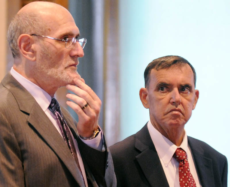 MAKING A MOTION: Rep. Frederick L. Wintle, R-Garland, right, listens to his attorney, Leonard Sharon, discuss the status of cases against him for criminal threatening with a dangerous weapon and carrying a concealed weapon during a Kennebec County Superior Court hearing held in August. Wintle is accused of pulling a loaded handgun on a stranger in a Waterville Dunkin' Donuts parking lot May 21.