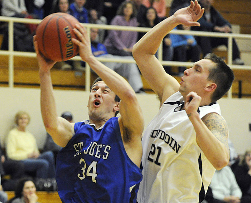Chris Petzy, who hit seven 3-pointers for St. Joseph s, goes inside against Ryan O Connell of Bowdoin in a 70-68 victory Tuesday night.