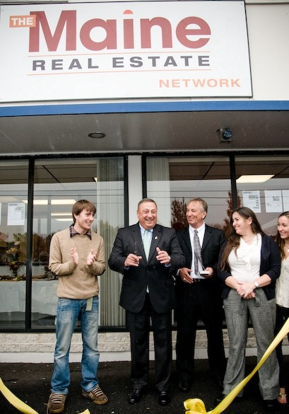 Gov. Paul LePage, second from left, recently attended a ribbon-cutting as The Maine Real Estate Network opened offices at 183 US Route 1 in Falmouth. Joining him, from left, are John Logan Jones, David Jones, Nancy Jones and Lauren Jones. The agency is one of five new businesses that began operating last month in the former Portland Saab building. The other companies include Falmouth Antiques & Furniture, Foreside Insurance Group, Fit 212 and Jones Building & Development. Town officials attending the Oct. 13 ceremony included Falmouth Town Manager Nathan Poore, several town councilors and Jonathan Berry, president of the Falmouth Economic Development Commission.