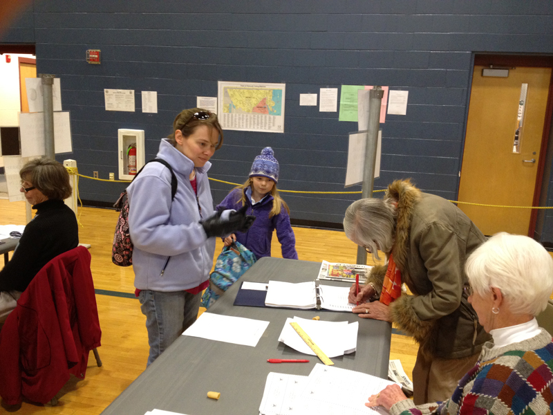 Linda Gee of Falmouth shares the voting experience with her daughter, Acadia Gee, 8, at Falmouth High School.
