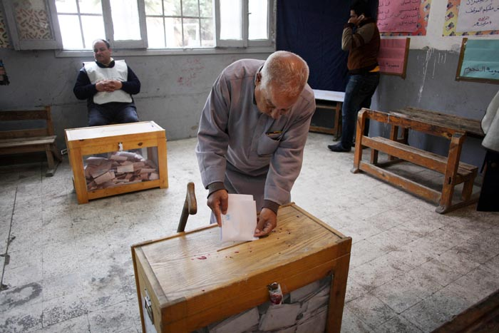 A man casts his ballot on the second day of parliamentary elections in Cairo, Egypt, today.