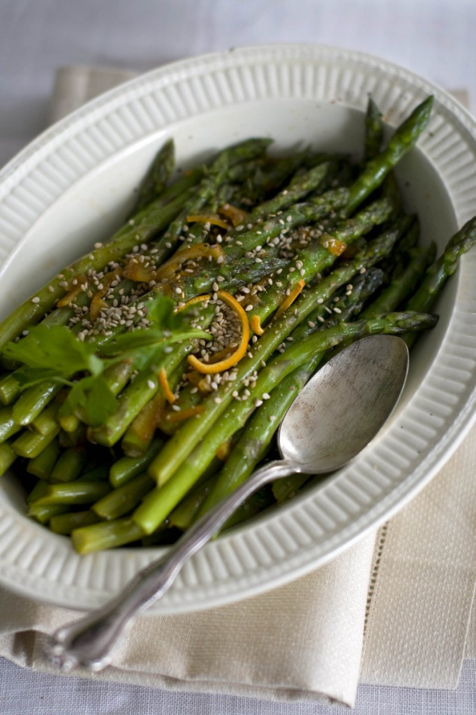 Citrus-glazed asparagus is dusted with toasted sesame seeds before serving.