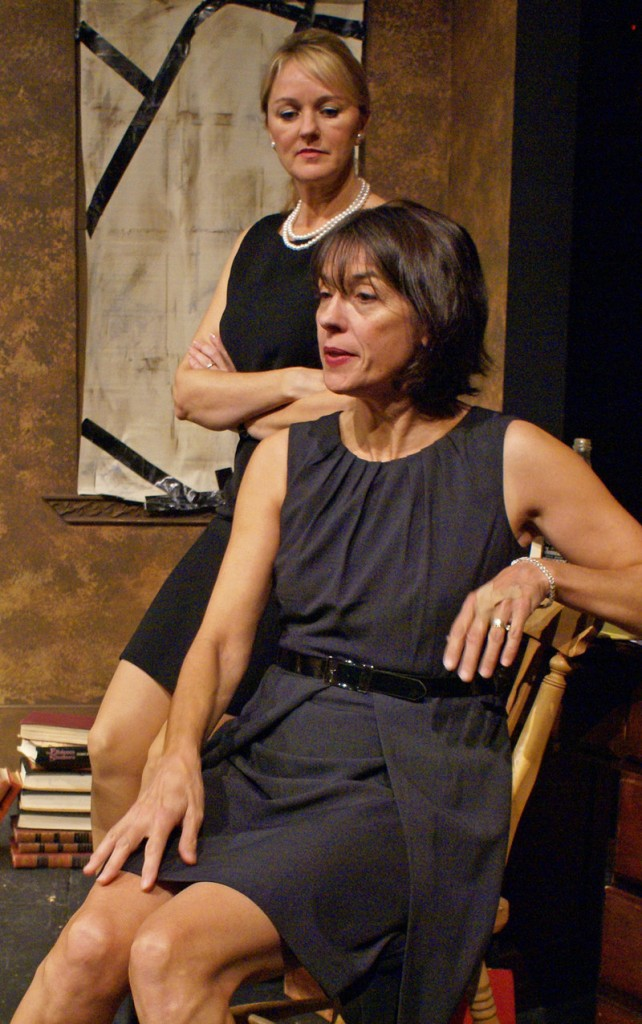 "Kathleen Kimball (standing) as Barbara and Lisa Stathoplos as Violet in ""August: Osage County"" at Good Theater."