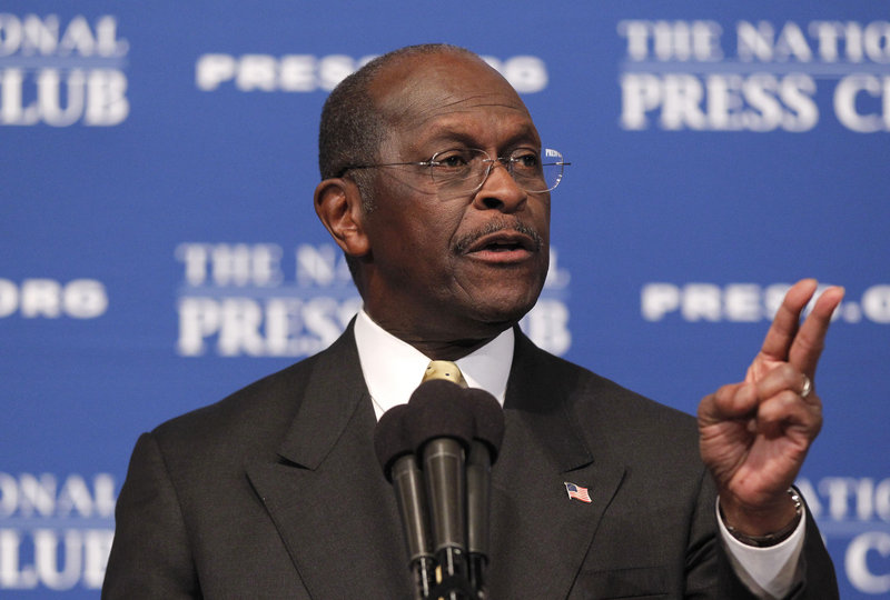 "GOP presidential candidate Herman Cain answers questions at the National Press Club. A prominent conservative called harassment allegations against Cain a ""high-tech lynching."""