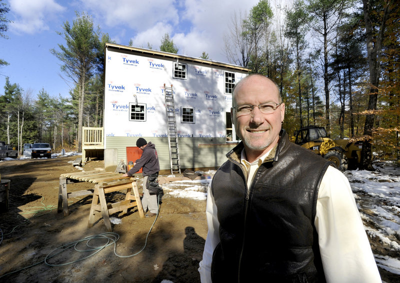 Mark Patterson, owner of Patco Construction, expects to build 25 single-family homes this year, compared to 53 in 2002, and so keeps fewer workers employed. He's shown here at a home his company is building in Lebanon.
