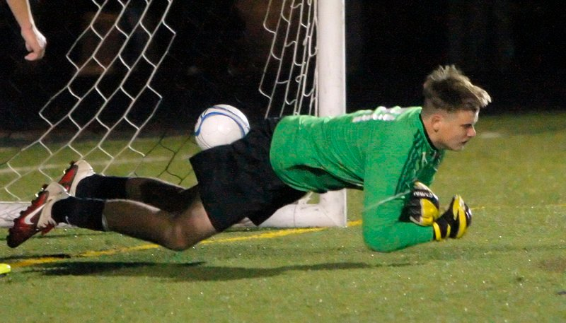 Pat Stanton of Scarborough dives for the ball Wednesday night in an effort to stop Bryan Soucy's goal that gave Windham the Western Class A boys' soccer title with a 1-0 victory.