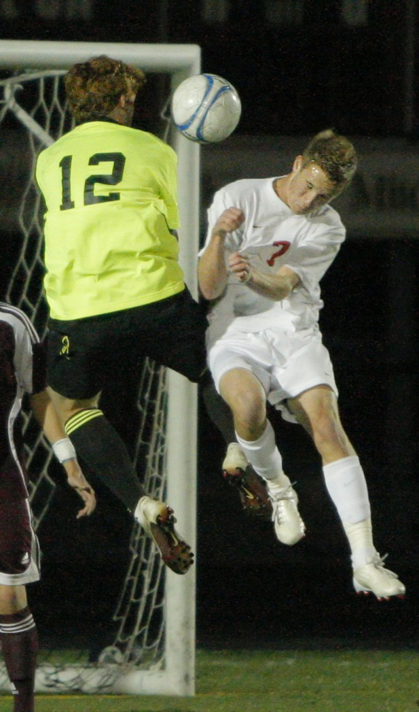 Windham goalkeeper Dana King, who earned his eighth shutout of the season, collides with Austin Downing of Scarborough while going for the ball.