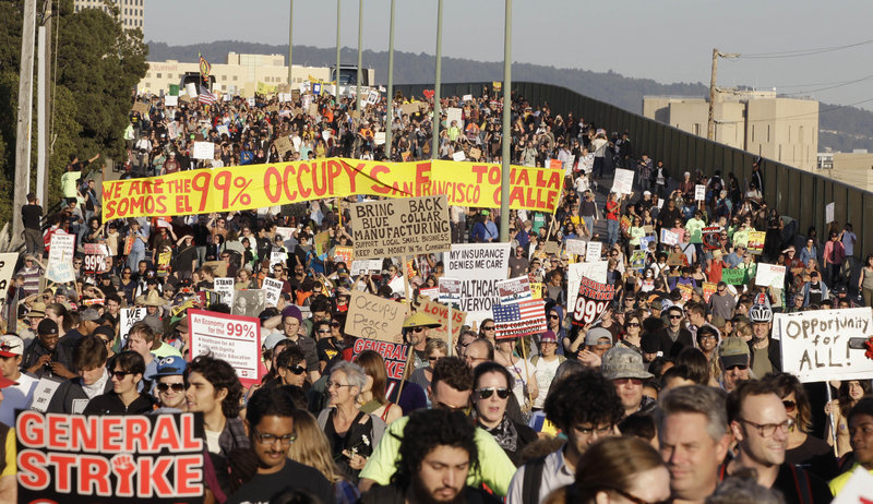 Thousands of Occupy Wall Street demonstrators march from downtown Oakland, Calif., to the port of Oakland on Wednesday, hoping to disrupt the flow of goods at the nation's fifth-busiest port.