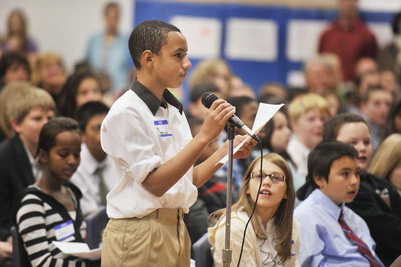 Seventh-grader Marcus Stevens asks a question during Thursday's forum at Lyman Moore Middle School as the mayoral candidates made one of their final pitches to voters.