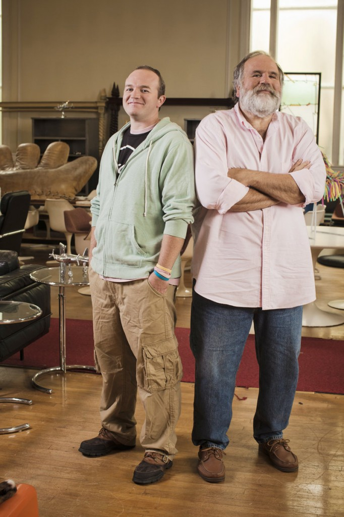 """The Pasternaks, Jerry, right, and his son Jeremiah, stand in their antiques warehouse in Rockland. A new Planet Green cable TV show features the pair's search for unusual antiques that they warehouse in Rockland and sell online. """"Our show is not just about the thrill of the hunt, it's also about the art of the deal,"""" says Jeremiah."""