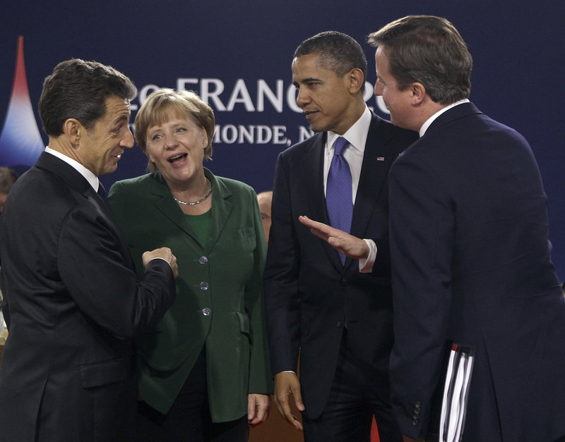 From left, French President Nicolas Sarkozy, German Chancellor Angela Merkel, President Obama and British Prime Minister David Cameron talk during a G-20 meeting in Cannes on Thursday. Obama capped his role at a brisk G-20 summit essentially where he started it, offering solidarity to his European peers with none-too-subtle signals it was their responsibility to clean up the economic mess in their own backyard.