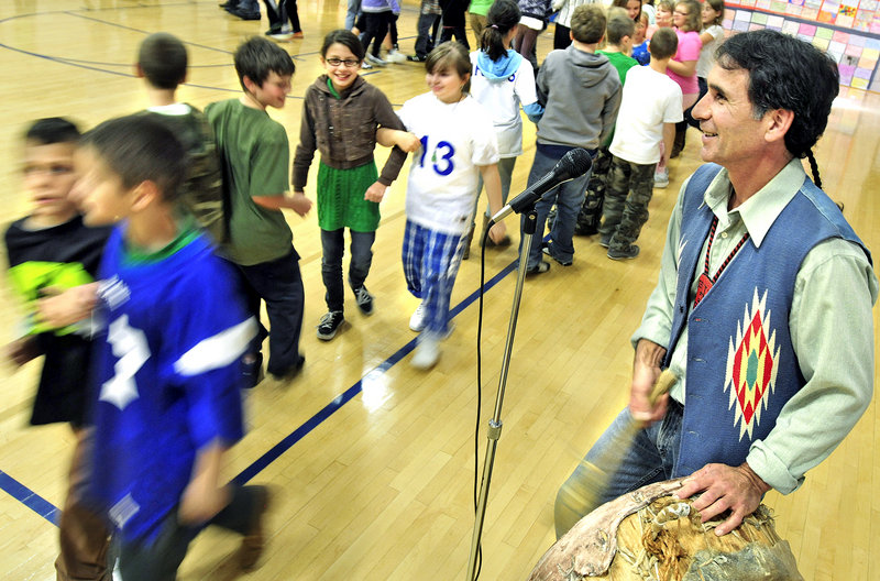 Barry Dana, a former chief of the Penobscot Nation, leads students in the alligator dance during an assembly at Sea Road School in Kennebunk on Friday. Dana spent a week teaching about traditional practices as an artist in residence at the school.