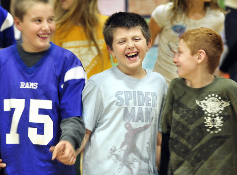 Bruno Belo, middle, and fellow Sea Road School fifth-graders Zach Johnson, left, and Colby Roy, right, perform the round dance, an American Indian tribal dance, at an assembly Friday.
