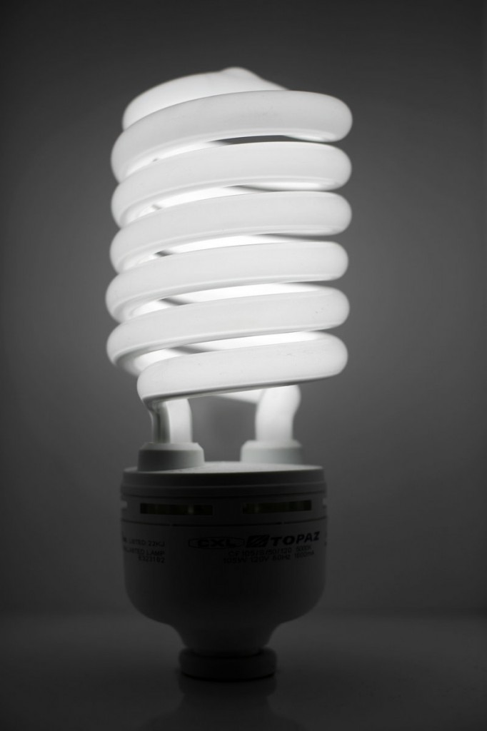Compact fluorescent light bulbs reduce energy consumption and greenhouse gas emissions.