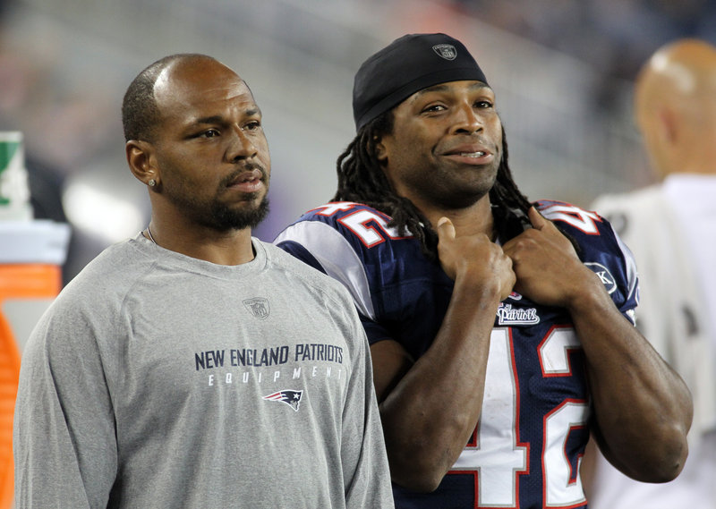 Kevin Faulk, left, with BenJarvus Green-Ellis.