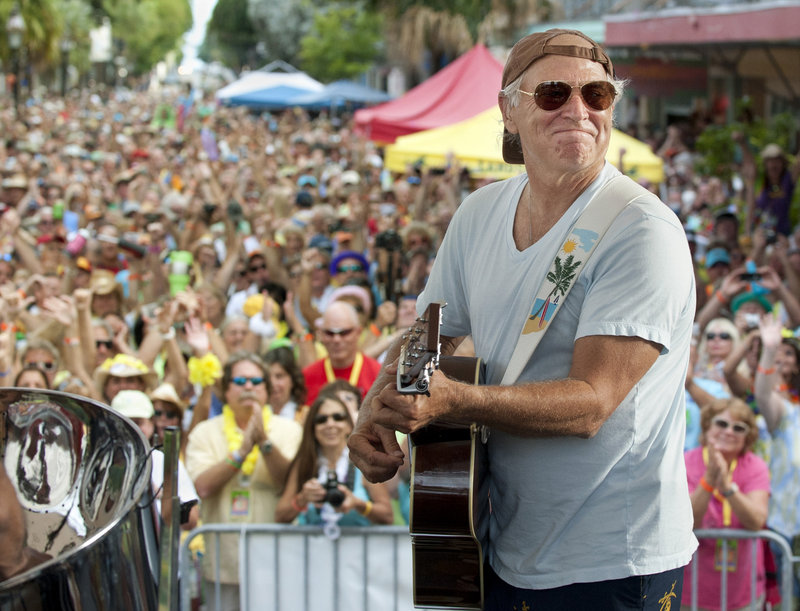 Jimmy Buffett surprised some 3,500 of his fans in Key West, Fla., with an appearance Friday at the Parrot Heads Convention.