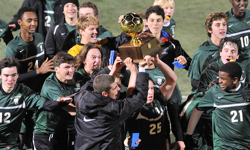 The Waynflete boys' soccer players have a Gold Ball to show off, and show it off they did Saturday, earning the trophy by beating Houlton in the Class C state championship game.