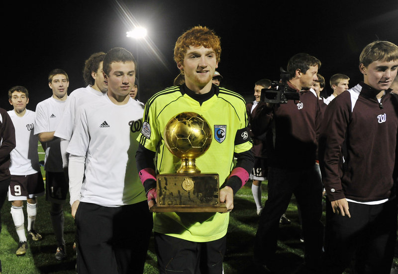 Windham keeper Dana King played a huge part in the Class A boys' soccer state final Saturday night, and got to carry the Gold Ball after the 3-1 victory against Messalonskee at Falmouth High. It was the first boys' soccer state championship for Windham.