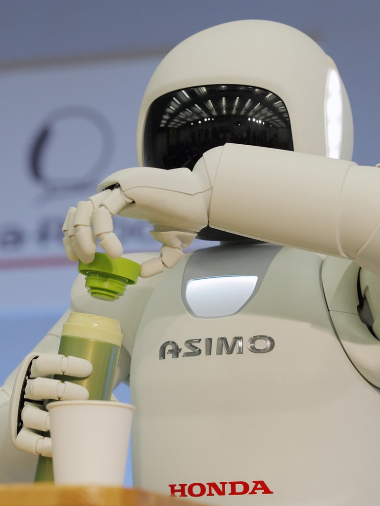Asimo has the ability to gracefully pour juice into a paper cup.