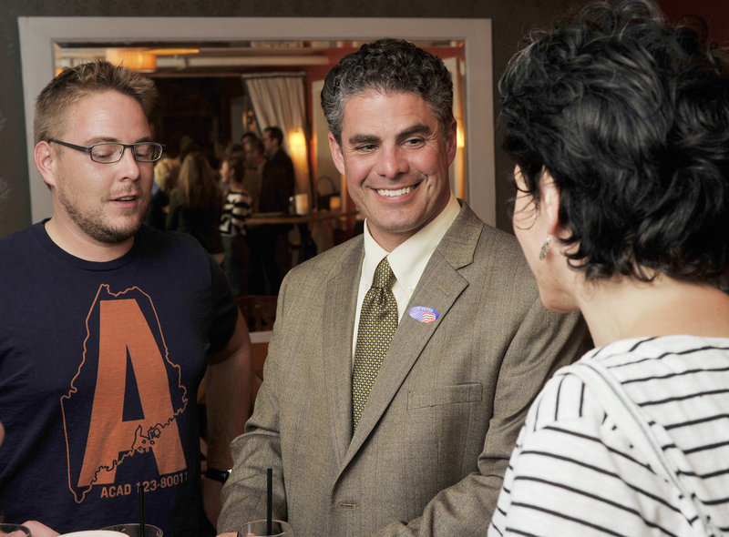 Portland mayoral candidate Ethan Strimling mingles with some of his supporters Tuesday night at Havana South on Wharf Street. Strimling is hoping Round 2 of ranked-choice voting tabulation will favor him.