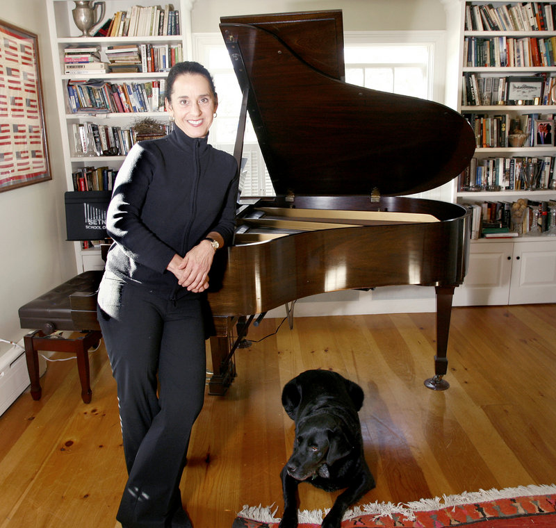 Janna Hymes and Winston at her restored 1850s home in Rockport. Hymes keeps it simple with Maine Pro Musica, the orchestra she founded in 2008, with no bureaucracy to speak of. She and the professional musicians of MPM have no home auditorium; rather, they traverse the state to perform in towns such as Ellsworth, Fryeburg, Rockland and Damariscotta.