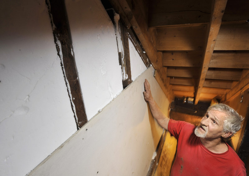 Mark Mowatt of Portland cut his oil use in half with a big weatherization effort on his Bradley Street home. Mowatt had the walls and attic insulated, the rim joist sealed and a new furnace installed at a cost of $10,000.