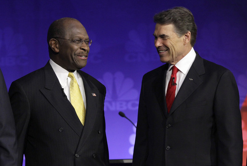 Republican presidential candidates businessman Herman Cain and Texas Gov. Rick Perry talk before the Republican presidential debate at Oakland University in Auburn Hills, Wednesday. The debate focused mostly on the economy with all the candidates sounding a similar refrain against direct U.S. aid in the European debt crisis.