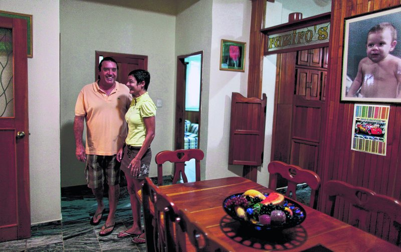 Tania Duran and her husband Fernando Ramiro stand Thursday in their home in Havana they have just put on the market A new housing law allowing Cubans to freely buy and sell their homes took effect Thursday.