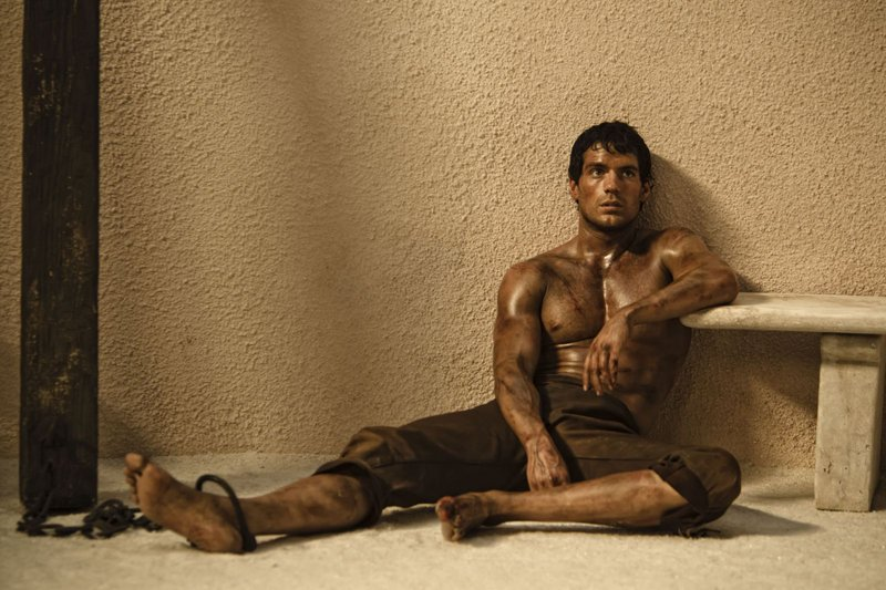 "Henry Cavill stars as Theseus, who is chosen by Zeus to battle an evil king played by Mickey Rourke in ""Immortals."""