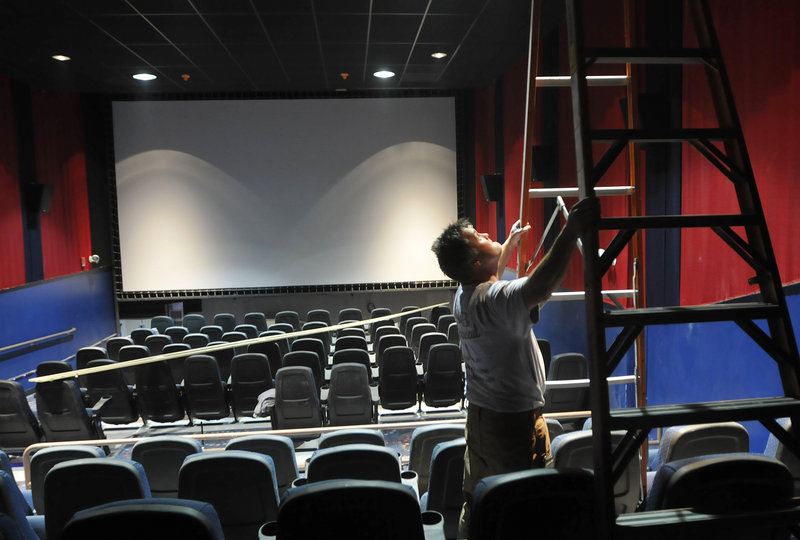 Jeff Savoie of S&B Mechanical works on the heating and cooling system Thursday at the new Nordica Theatre in Freeport, where finishing touches are being completed to prepare for the theater s opening next week.