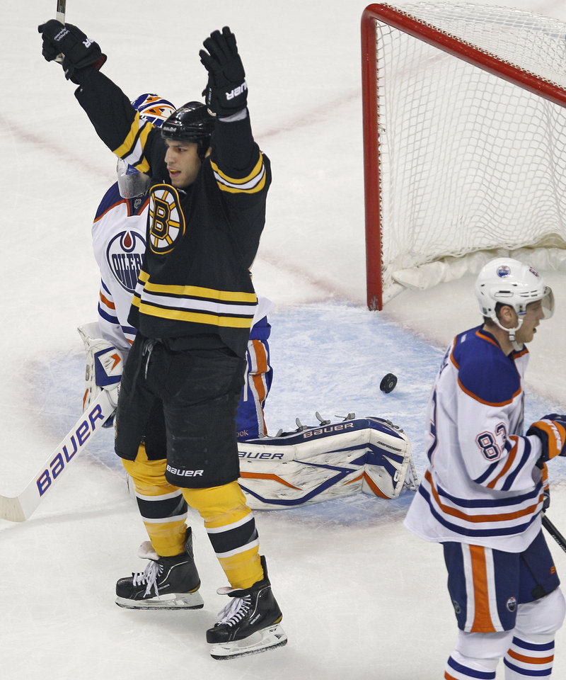 Milan Lucic celebrates after a shot by Bruins defenseman Johnny Boychuk eluded Edmonton goalie Devan Dubnyk for a first-period goal Thursday. Lucic scored in the third period to help Boston secure a 6-3 win.
