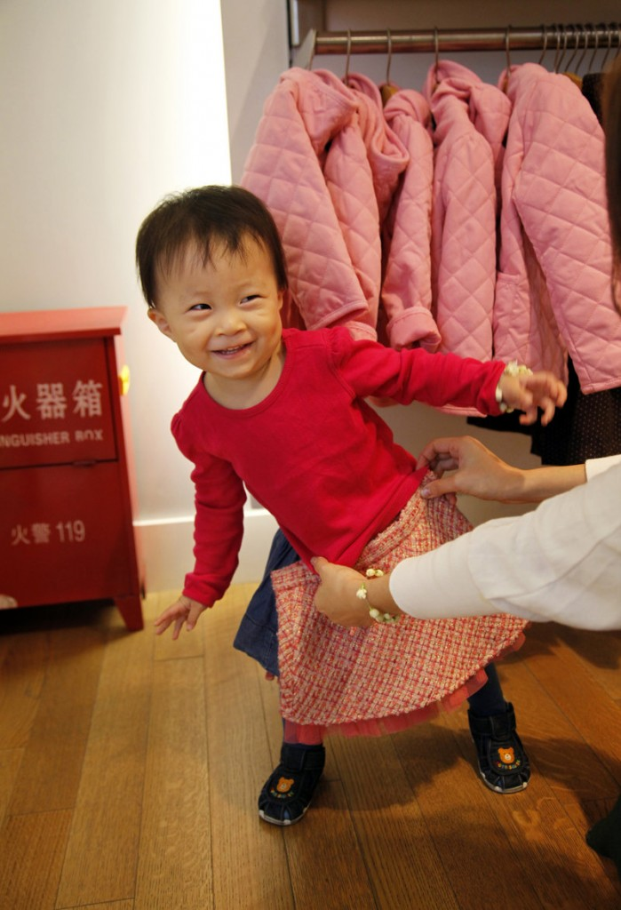 A shopper checks the fit on a skirt for her daughter at the Gap store in Shanghai. As the American market continues to sputter, Gap, Levi Strauss and other U.S. retailers are updating their business plans to include the world's second-largest economy, as well as the rest of growing Asia.