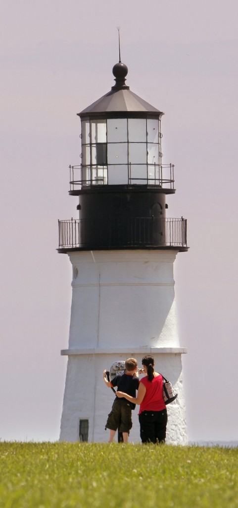 Melissa Dorfman and her son Parker Nelson, 7, take in the view near Portland Head Light at Fort Williams Park in Cape Elizabeth in June. A big part of the attraction to the park is Portland Head Light, which was built in the late 1700s.