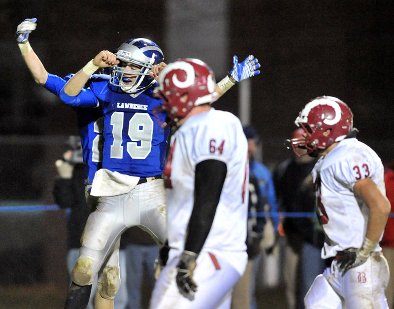 Alex Leathers of Lawrence celebrates Friday night after scoring a second-quarter touchdown in a 40-14 victory against Bangor in the Eastern Class A final.